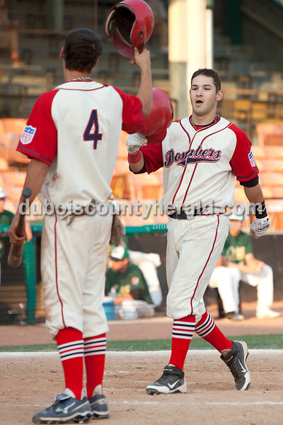Dave Weatherwax/The Herald<br /> Dubois County Bombers' Landon Curry, left, congratulated teammate Frank Rawdow after Rawdow hit a home run during Wednesday night's game against Quincy at League Stadium in Huntingburg. The Bombers won 9-5.