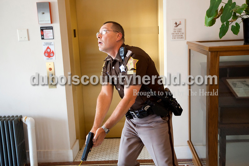 Dubois County Courthouse security officer Michael Shaw scanned the first floor of the courthouse during the active shooter training scenario on Tuesday.