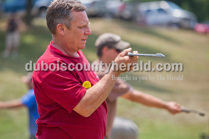 Rachel Mummey/The Herald<br /> Bill Troesch of Ferdinand aimed his horseshoe carefully during the horseshoe tournament at the Heimatfest in Ferdinand on Saturday afternoon. His tournament partner was John Flamion of Santa Claus.