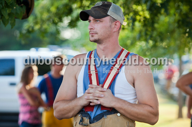 Rachel Mummey/The Herald<br /> Nick Nowakowski of Jasper watched the waterball competition during the Heimatfest in Ferdinand on Friday evening. Nowakowski, is a member of the Jasper Volunteer Fire Department, who had a team compete in the competition.