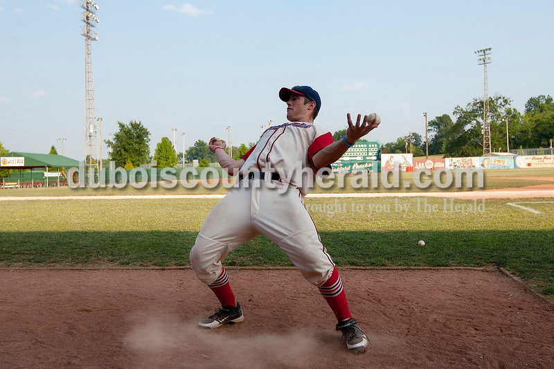 Dubois County Bombers' Scott Windler attempted to catch a baseball in each hand after they were thrown high into the air by Spencer Sapp before the start of Wednesday night's game against Quincy at League Stadium in Huntingburg. The Bombers won 9-5. Dave Weatherwax/The Herald
