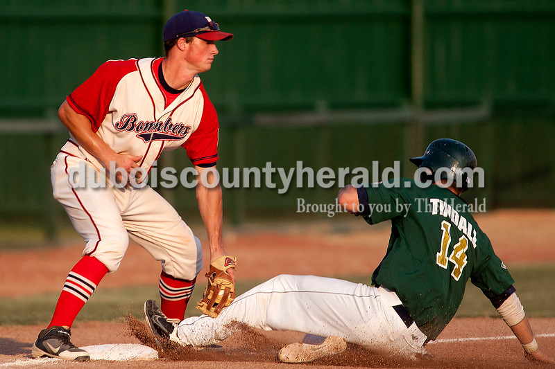 Dave Weatherwax/The Herald<br /> Dubois County Bombers' third baseman Cody Daily applied the tag to Quincy's Nick Tindall during Wednesday's game at League Stadium in Huntingburg. Tindall was called safe on the play.