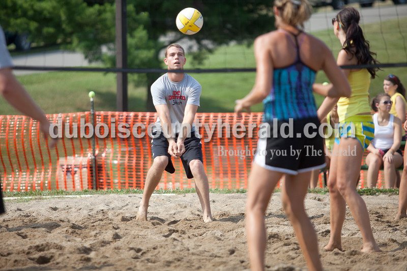 Rachel Mummey/The Herald<br /> Kurt Fromme of Ferdinand bumped the volleyball during the co-ed volleyball tournament at the Heimatfest on Saturday. Also on his team was Jade Hooper, Kylie Blessinger, 17, Kalyn Wendholt, Matthew Wilmes and Aaron Trafton, all of Ferdinand. The volleyball tournament was co-sponsored by the Town of Ferdinand and Tri-County YMCA.