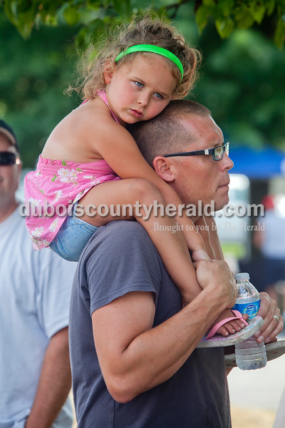 Rachel Mummey/The Herald<br /> Jeff Brown of Jasper provided a head rest for his daughter, Elyse Brown of Jasper, 3, during the antique car show during the Heimatfest in Ferdinand on Saturday.