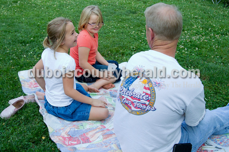 Brooke Stevens/The Herald<br /> Twins Taylor, left, and Tory Ziegler joked around with their dad Rick of Huntingburg during Music in the Park at the Huntingburg City Park Saturday evening. Free music, food and drinks were provided by the Huntingburg City Advisory Board.