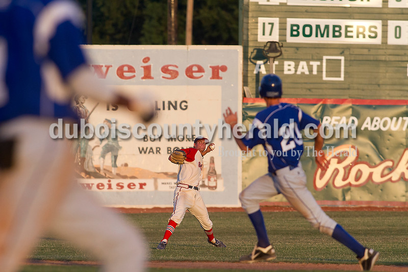 Brooke Stevens/The Herald<br /> Bomber Landon Curry threw the ball to the infield during Wednesday nights game against Terre Haute Rex at League Stadium.