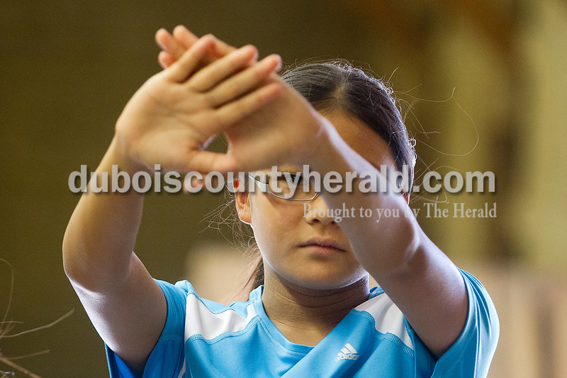 Brooke Stevens/The Herald<br /> Susanna Fravell of Celestine, 12, held her hands up for an eye dominance test during 4-H Shooting Sports Archery Camp Monday night. Fravell gained interest in archery after reading The Hunger Games, a book where one of the main characters is a female archer.