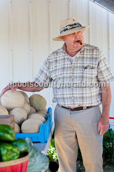 Rachel Mummey/The Herald<br /> Tony Merder of Jasper, paused to chat with a customer as he organized his produce stand at his home on Mill Street on Tuesday morning. Merder has sold produce from Gibson County out of his home on Mill Street for the past three years.