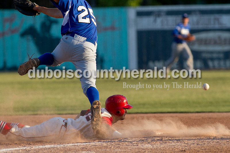 Brooke Stevens/The Herald<br /> Bomber Frank Rawdow slid into first while Rex Kyle Zimmerman jumped for the ball during Wednesday nights game against Terre Haute Rex at League Stadium.