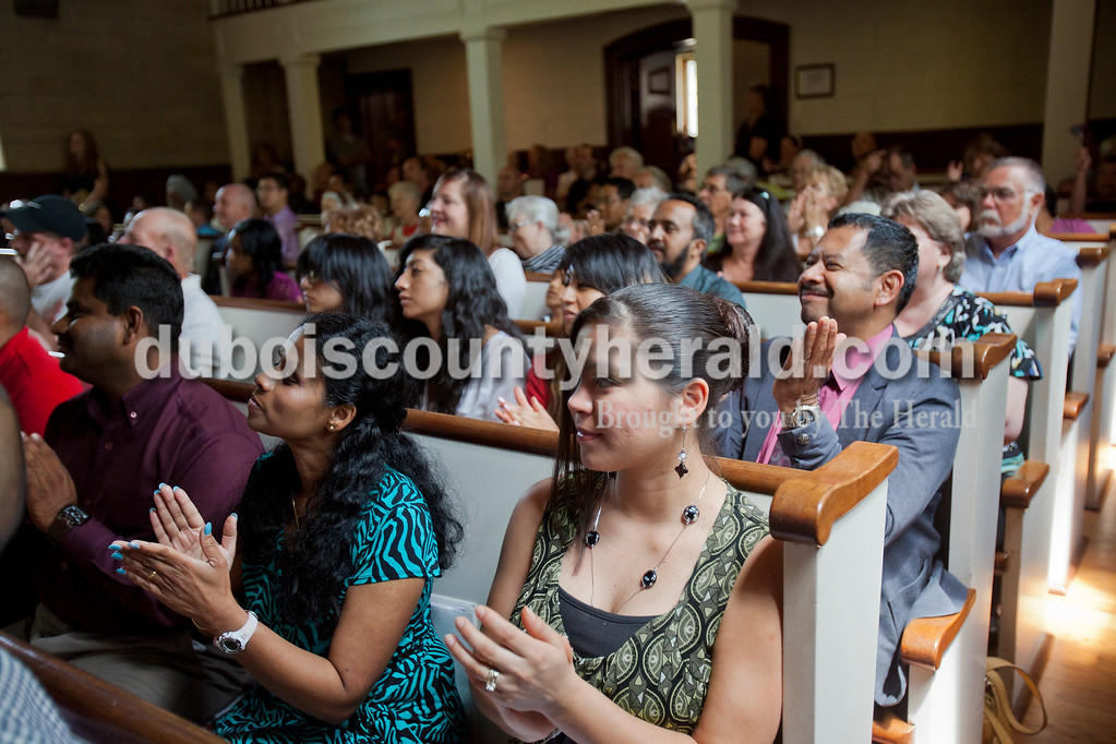 Rachel Mummey/The Herald<br /> Shanbaga Sivakumar of Newburgh and Cecilia Betancourt of Greenwood applauded during the naturalization ceremony at the Lincoln Boyhood National Memorial on Tuesday. Sivakumar is originally from India and Betancourt is originally from El Salvador
