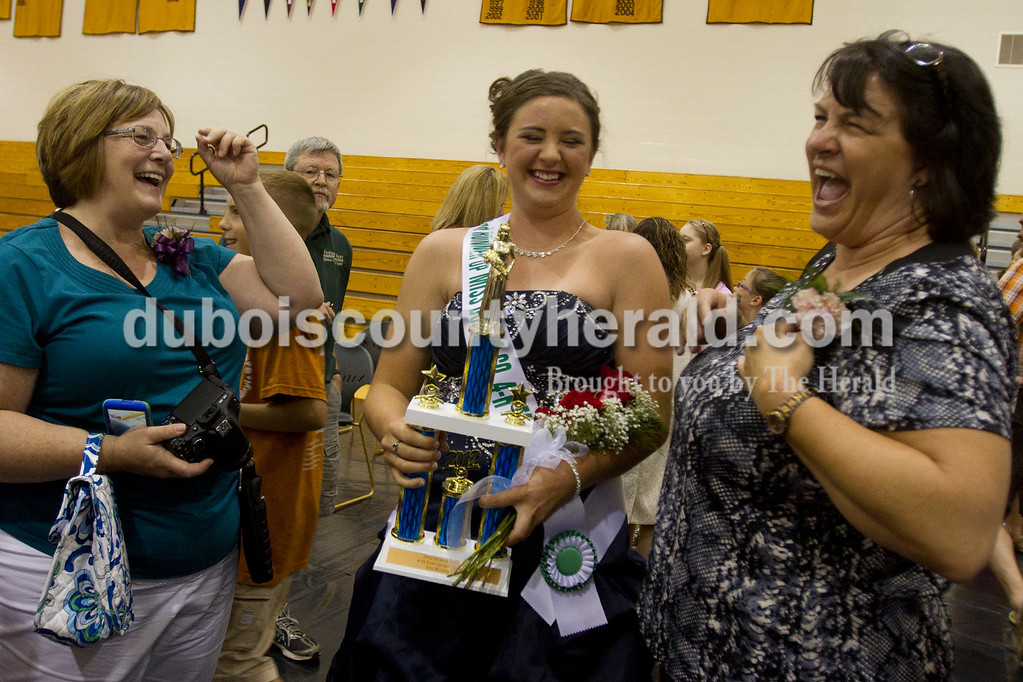 Olivia Corya/The Herald<br /> Dubois county 4-H Fair Contest second runner up Olivia Steckler of Ferdinand, 18, center, laughs with her aunt Carma Gentry of Jasper, left, and friend Kathy Hopf of St. Anthony after the competition ended at Jasper Middle School Saturday. Hopf, whose own daughter participated in the competition, helped Steckler shop for her professional wear for the contest, and joked that she deserved credit for Steckler's win.