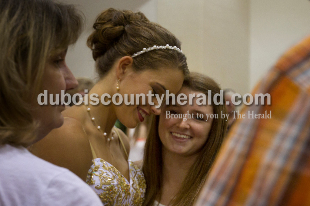 Olivia Corya/The Herald<br /> Kayla Brahm, 17, right, consoled her best friend Allison Hoffman of Huntingburg, 18, as Hoffman's mother Amy Hoffman of Huntingburg stood nearby after  Hoffman did not place in the Dubois County 4-H Fair Queen Contest at Jasper Middle School Saturday.