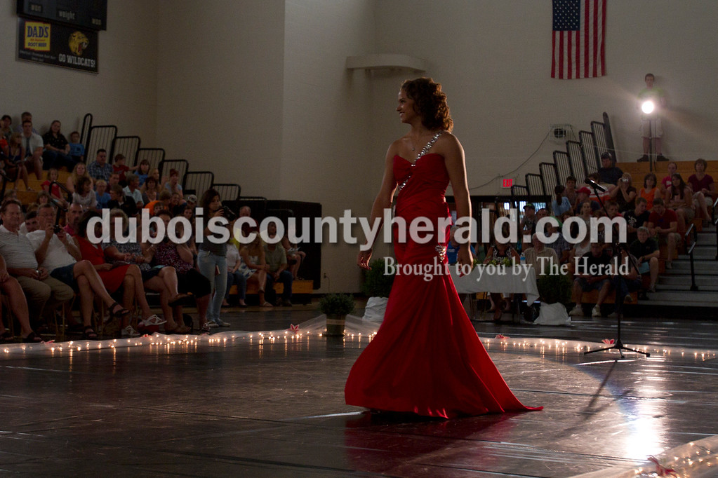 Olivia Corya/The Herald<br /> Kateland Bailey of Dubois, 17, showed off her evening gown during the Dubois County 4-H Fair Queen Contest at Jasper Middle School Saturday. Bailey was one of fourteen women competing for the title of queen.