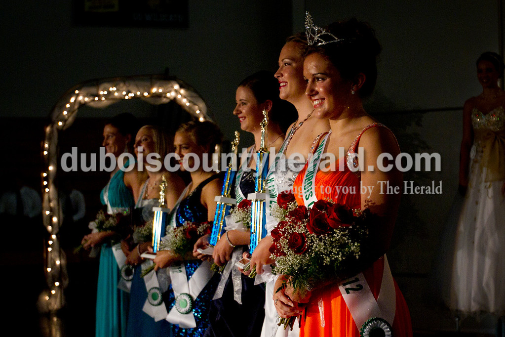 Olivia Corya/The Herald<br /> 2012 Dubois County 4-H Fair Queen Rhegann B. Fetter of Huntingburg, 18, stood with her fellow pageant royalty after being crowned queen at Jasper Middle School Saturday. Next to her, from right to left, stood first runner up Samantha Hopf of Huntingburg, 18, second runner up Olivia Steckler of Ferdinand, 18, third runner up Jennifer Bromm of St. Anthony, 18, Miss Photogenic Jordan E. Houchin of Ferdinand, 19, and Miss Congeniality Nicole Bueltel of Huntingburg, 18.
