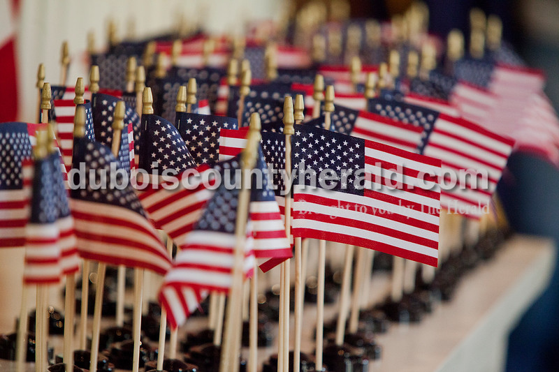 Rachel Mummey/The Herald<br /> Tiny American flags were given out to new citizens after the naturalization ceremony at the Lincoln Boyhood National Memorial on Tuesday. New citizens were also given voter registration cards so that they can vote in the upcoming presidential election.