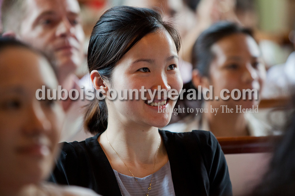 Rachel Mummey/The Herald<br /> Meirong Huang of Indianapolis smiled as she and her husband, Jing Ye, became citizens through the naturalization ceremony at the Lincoln Boyhood National Memorial on Tuesday. The couple is originally from China.