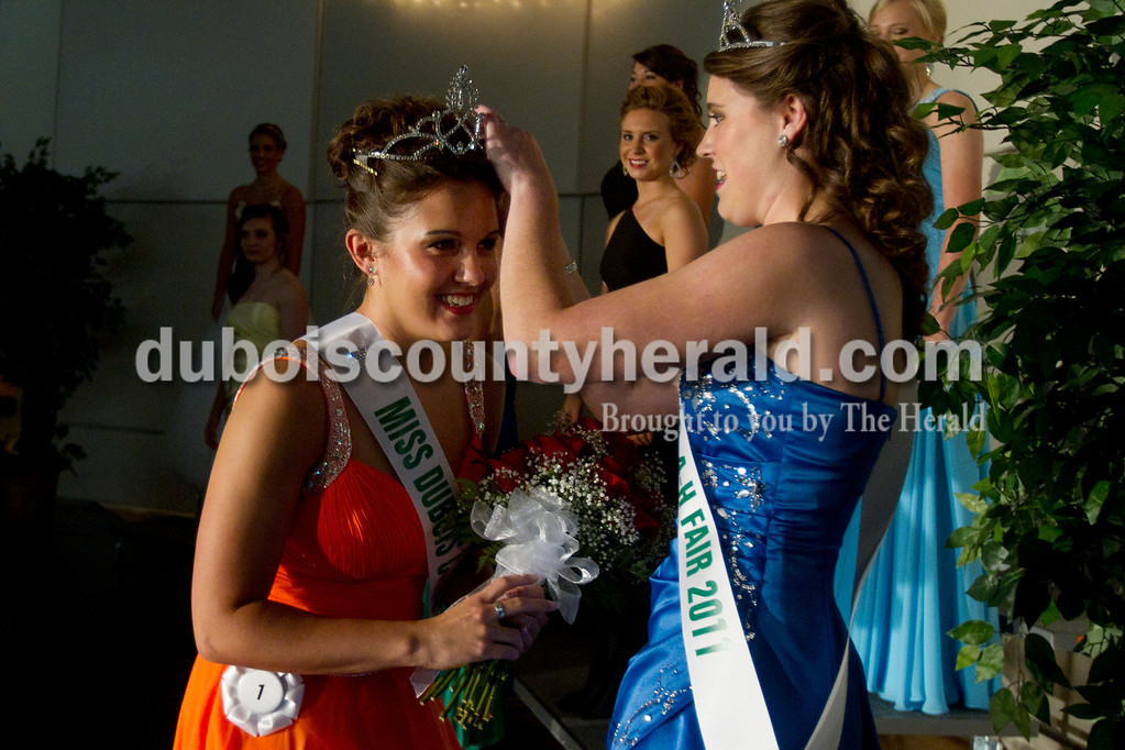 Olivia Corya/The Herald<br /> 2012 Dubois County 4-H Fair Queen Rhegann B. Fetter of Huntingburg, 18, received her crown from 2011 Queen Kaitlin Emmert of Ferdinand after being announced the winner at Jasper Middle School Saturday. Fetter, who plans to attend Rose-Hulman Institute of Technology to study electrical engineering,  will reign over the fair from July 15 to 21.