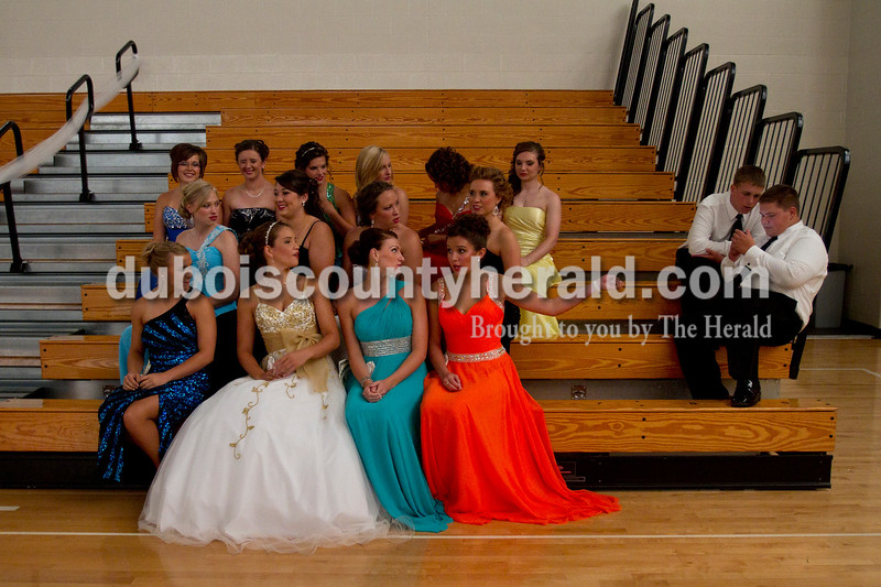 Olivia Corya/The Herald<br /> The fourteen women competing in the Dubois County 4-H Fair Queen Contest asked to include their ushers Brayden Schuetter of Forest Park High School, 16, left, and Ted Boeglin of Jasper High School, 16, as the ladies posed for a photo while waiting for the judges to decide the winners at Jasper Middle School Saturday. Rhegann B. Fetter of Huntingburg, 18, in the far right of the front row, was crowned Queen, and she will reign over the fair from July 15 to 21.