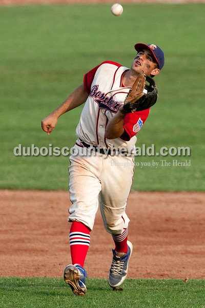 Dave Weatherwax/The Herald<br /> Dubois County Bombers shortstop Dalton Rouleau fielded the Quincy Gems hit during the first game in the doubleheader against the Quincy Gems on Monday at League Stadium in Huntingburg.
