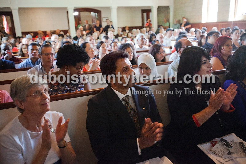 Rachel Mummey/The Herald<br /> Evelyn Adams of Tobinsport, Sanjay Gopalakrishnan of Greenwood, and Rebeca Rodriguez of Indianapolis applauded during the naturalization ceremony at the Lincoln Boyhood National Memorial on Tuesday. Gopalakrishnan is originally from India and Rodriguez is originally from Mexico.