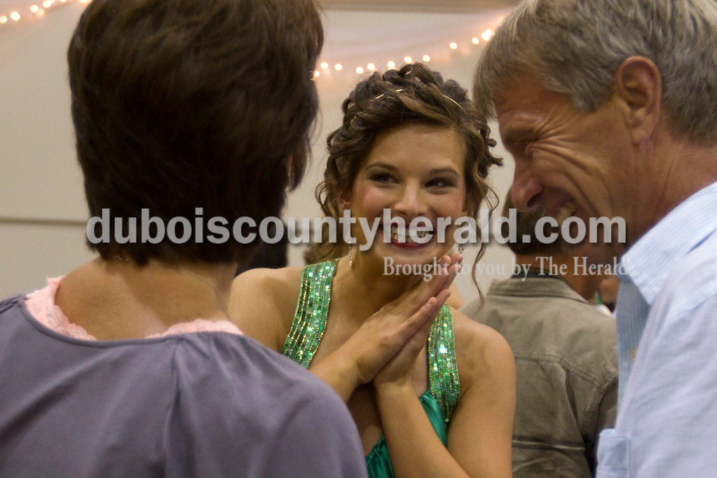 Olivia Corya/The Herald<br /> Dubois County 4-H Fair Queen Contest participant Mekenna Knies of Celestine, 18, center, talked with her godmother Deb Knies and her uncle Roger Knies, both of Celestine, after the competition was over at Jasper Middle School Saturday.