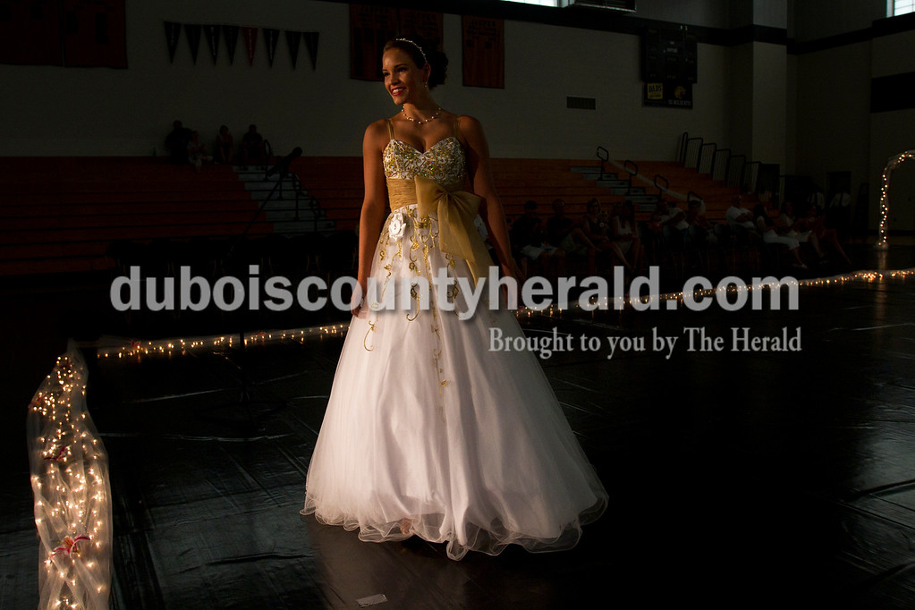 Olivia Corya/The Herald<br /> Allison Hoffman of Huntingburg, 18, smiled at the judges during the Dubois County 4-H Fair Queen Contest at Jasper Middle School Saturday. Hoffman was one of fourteen participants in the competition, which included an interview and professional and formal wear portions.