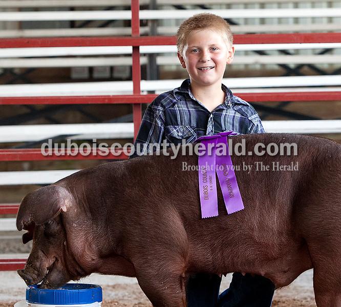 Cody Scherle: grand champion breeding gilt, grand champion commercial barrow, junior champion showman