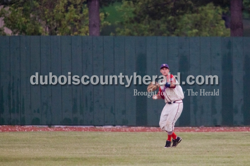 Rachel Mummey/The Herald<br /> Dubois County Bombers' Austin Nyman threw a ball back in from the outfield during the Bombers game against the Springfield Sliders at League Stadium on Huntingburg on Tuesday evening.