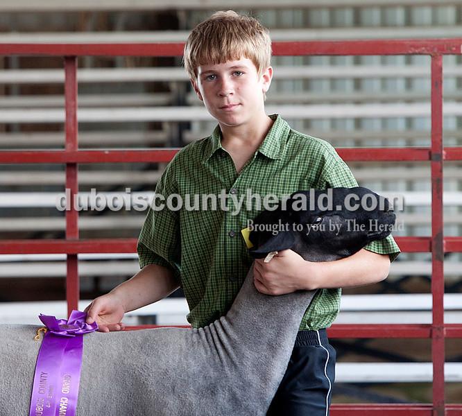 Cole Oeding: grand champion breeding ram — wool, intermediate champion showman