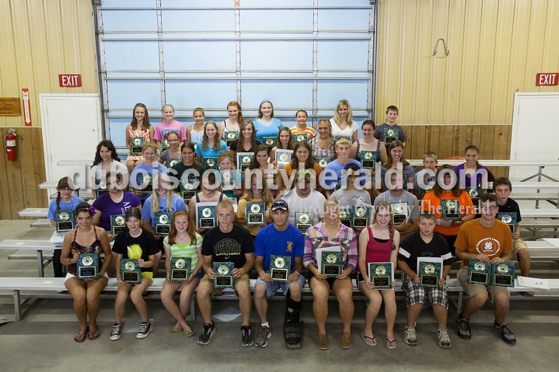 Rachel Mummey/The HeraldWinning grand champion ribbons and achievement awards at the Dubois County 4-H Fair last week are, from left, first row: Alexa Wollenmann, scrapbooking; Amy Metz, cat; Ashely Whitsitt, creative writing; Austin Egloff, pigeon; Bryan Hurst, woodworking; Cassandra Wertman, hay; Cosette Ferhibach, drawing; Dalton Lampert, small engines; and Drew Weyer, americana, farm scene.<br /> <br /> Second row: Gabriella Eck, demonstration, entomology, geology, weather, soil and water conservations; Gabrielle Archer, microwave cooking; Hailey Thayer, bicycle; Haley Gudorf, reed craft; Hannah Gunselman, rug hooking; Jacob Hoffman, model craft; James Merkley, ducks, small pets; Jarrett Hopf, garden; Jasmine Curtis, dog obedience; and Jason Sermersheim, woodcraft.<br /> <br /> Third row: Jennifer Merkley, fancy breeds-standard, geneology; Joanna Ballard, child development; Jorden Voges, fancy breeds-bantam; Kari Anne Scherzinger, poultry-pullets; Karissa Wollenmann, candlemaking; Kayle Mehne, sewing; Keith Hurst, health; Kelci Hassfurther, gift wrapping; Lane Knies, turkey; and Lauren Tretter, sports. <br /> <br /> Fourth row: Madelynne Wagner, home environment; Marissa Emmert, collections; Marissa Weisman, memory books; Millie Prechtel, consumer clothing; Natalie Jacob, days gone by; and Olivia Steckler, crops. <br /> <br /> Fifth row: Payton Prechtel, floriculture; Rylee Hedinger, electric; Sarah Pund, cake decorating and Wilton Cake Decorating Award; Shannon Sonderman, leathercraft; Taylor Blalock, clogging; Taylor Neukam, photography; Tiffany Wineinger, vererinary science and Wyatt Goeppner, poultry-hen.<br /> <br /> Not pictured: Allison Welp, counted cross stitch; Brianna Sizemore, personality; Brittany Rasche, crochet, decorative painting and wearables; Hannah Rydberg, public speaking; Ian Wilson metalcraft; Jessica Fromme, ceramics; Kyle Fisher, computer; Lori Uebelhor, embroidery; Luke Fleck, tractor; Lynette Whitsitt, painting; Megan Hoffman, needlepo