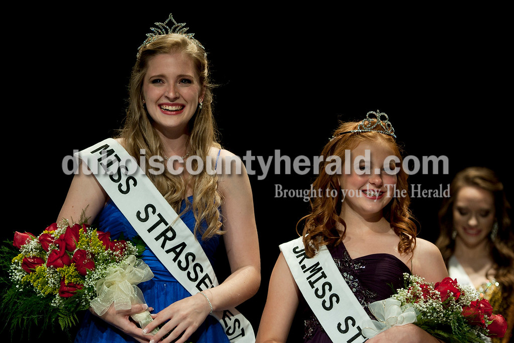 Olivia Corya/The Herald<br /> 2012 Miss Strassenfest Charlotte Olson of Jasper, 19, left, and Jr. Miss Strassenfest Ashley Whitsitt of Jasper, 12, smiled at the audience after being crowned at the Jasper Middle School Saturday. Olson and Whitsitt will get to reign at Strassenfest along with Little Miss Delaney Wigand and Little Mister Mason Schoenbachler.