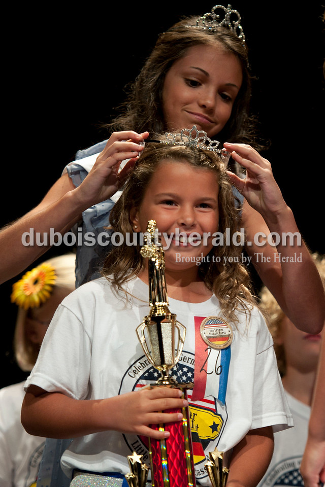 Olivia Corya/The Herald<br /> 2011 Jr. Miss Strassenfest Chloe Smith of Jasper, 12, crowned Delaney Wigand of Jasper, 8, as 2012 Little Miss Strassenfest at the Jasper Middle School Saturday. Among other prizes, Wigand and Little Mister winner Mason Schoenbachler of Jasper, 7, will receive a $100 savings bond and get to reign with the older royalty at Strassenfest.