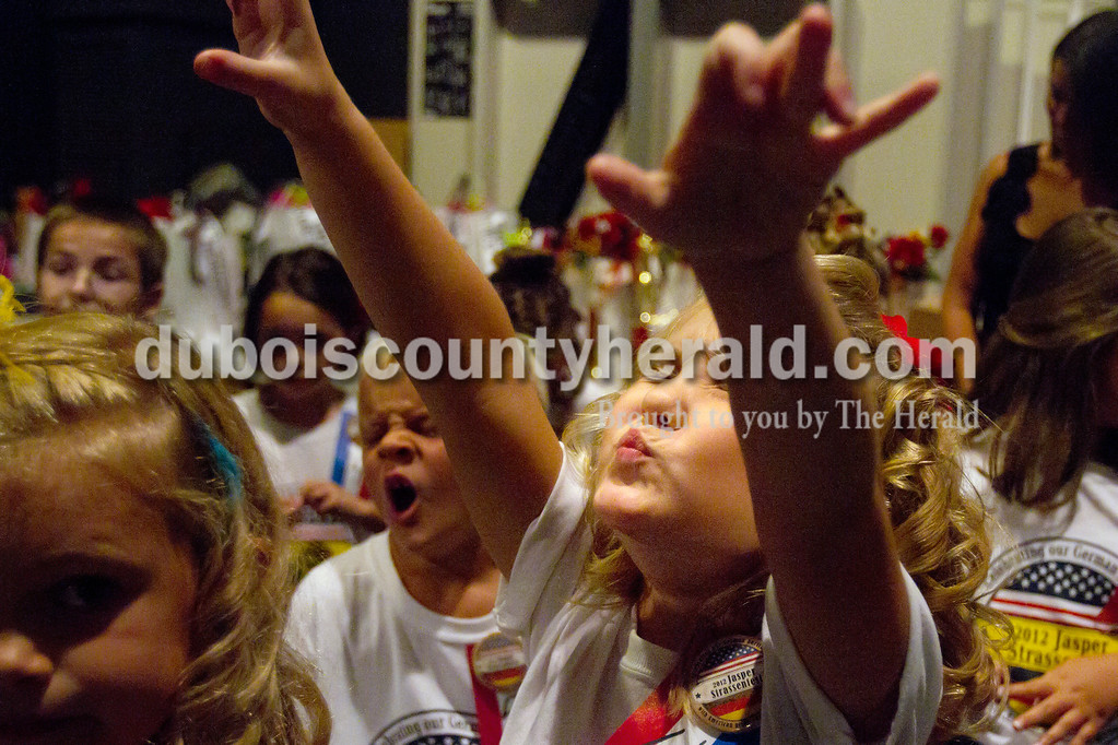 Olivia Corya/The Herald<br /> 2012 Little Miss Strassenfest contestant Grace Jarboe of Jasper, 8, crossed her fingers backstage as she wished that she would win at the Jasper Middle School Saturday. The winner this year was Delaney Wigand of Jasper, 8.