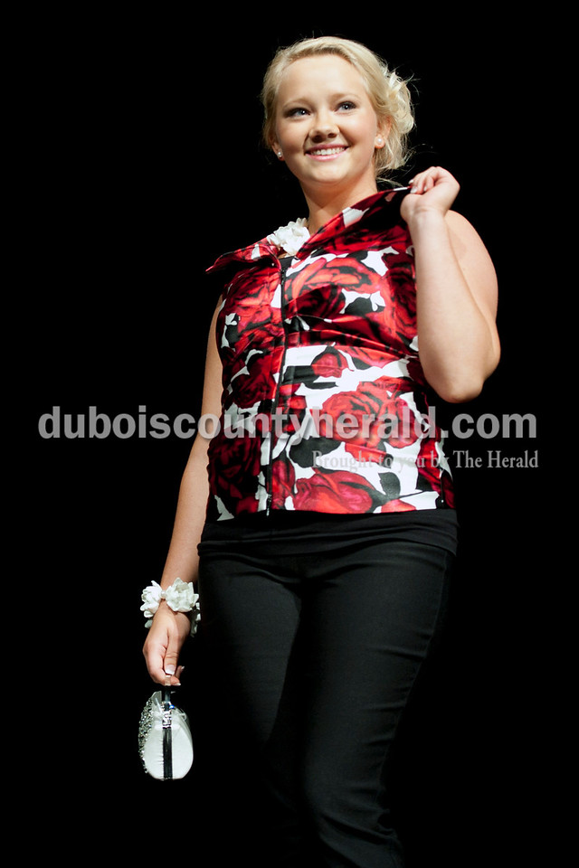 Olivia Corya/The Herald<br /> 2012 Miss Strassenfest contestant Katie Letterman of Jasper, 18, showed off a floral top during the modeling portion of the pageant at the Jasper Middle School Saturday. Letterman won Miss Photogenic.