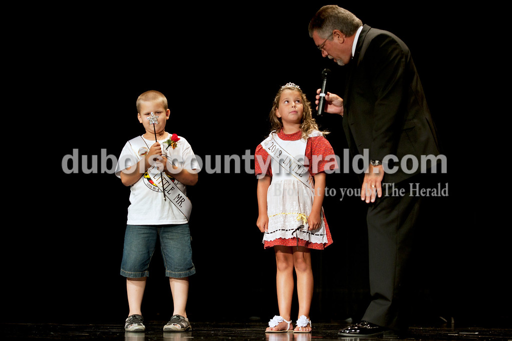 Olivia Corya/The Herald<br /> Emcee Gene Kuntz presented 2012 Little Miss and Little Mister, Delaney Wigand of Jasper, 8, and Mason Schoenbachler of Jasper, 7, to the audience at the Jasper Middle School Saturday. Among other prizes, Wigand and Schoenbachler will receive a $100 savings bond and get to reign with the older royalty at Strassenfest.