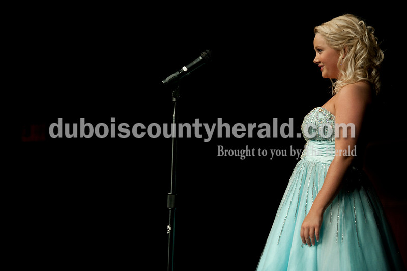 Olivia Corya/The Herald<br /> 2012 Miss Strassenfest contestant Katie Letterman of Jasper, 18, stepped up to the mic during the on-stage interview portion of the pageant at the Jasper Middle School Saturday. Letterman won Miss Photogenic.