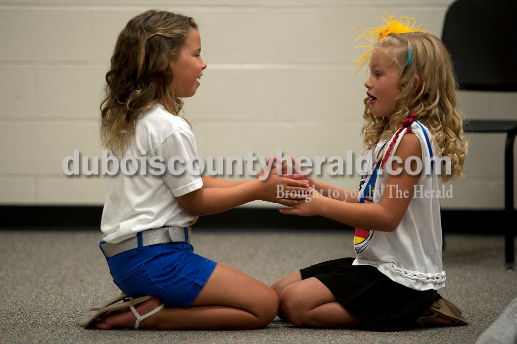 Olivia Corya/The Herald<br /> 2012 Little Miss Strassenfest Delaney Wigand of Jasper, 8, played with another contestant, Hannah Seifert of Jasper, 8, as they waited for the pageant to begin at the Jasper Middle School Saturday. Among other prizes, Wigand and Little Mister Mason Schoenbachler of Jasper, 7, will receive a $100 savings bond and will get to reign with the older royalty at Strassenfest.
