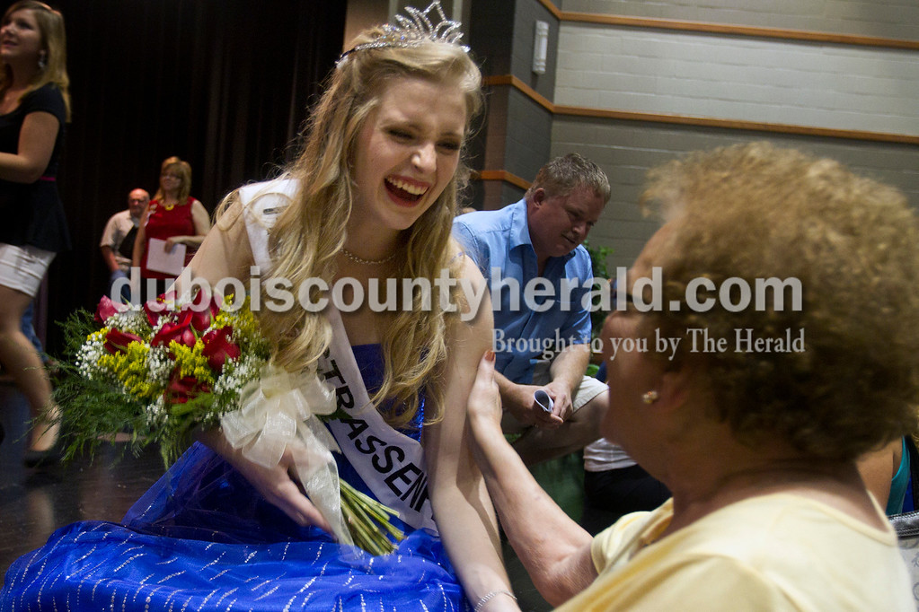 Olivia Corya/The Herald<br /> 2012 Miss Strassenfest Charlotte Olson of Jasper, 19, stretched to hug Mary Ann Kippenbrock of Jasper after Olson was crowned as the winner at the Jasper Middle School Saturday. Pageant contestants participated in a community service project of their choice, and Olson volunteered at Northwood Retirement Community, where she met Kippenbrock.