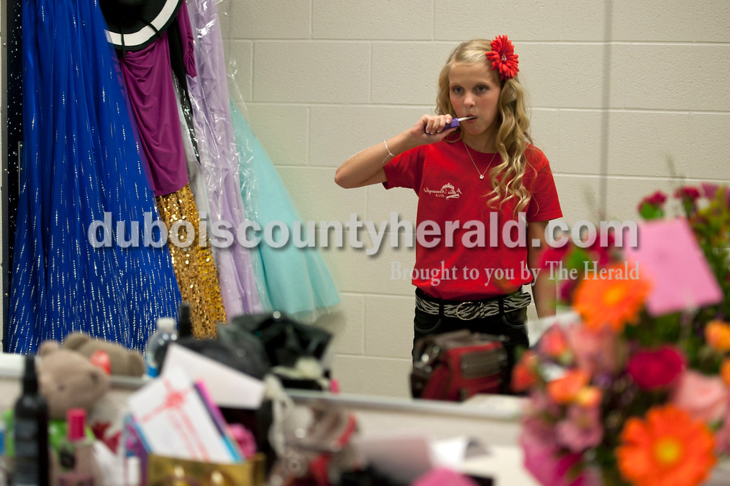 Olivia Corya/The Herald<br /> 2012 Jr. Miss Strassenfest contestant Hannah Welp of Jasper, 12, brushed her teeth before the pageant began at the Jasper Middle School Saturday. Later in the night Welp was awarded second runner-up.