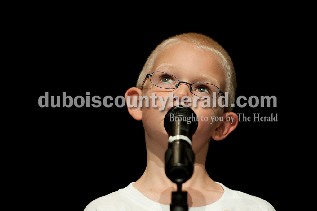 Olivia Corya/The Herald<br /> 2012 Little Mister Strassenfest contestant Jonathan Thurman of Jasper, 7, paused before answering an interview question in front of a panel of judges and the audience at the Jasper Middle School Saturday. Thurman was second runner up for Little Mister.