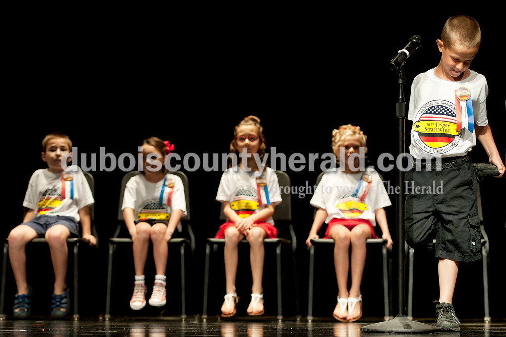 Olivia Corya/The Herald<br /> 2012 Little Mister Strassenfest contestant Zachary Mehringer of Jasper, 8, twisted nervously on stage as he answered interview questions in front of a panel of judges and the audience at the Jasper Middle School Saturday. The contestants had to answer basic questions about themselves, including if they had any pets, their favorite school subjects, and what they like to do for fun.