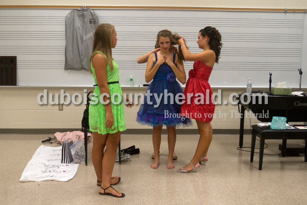 Olivia Corya/The Herald<br /> Jr. Miss Strassenfest contestants Kathryn Wigand of Jasper, 13, left, Priscilla Olson of Jasper, 13, center, and Hilary Bauer of Jasper, 13, right, changed into their formal wear before the second stage of the pageant at the Jasper Middle School Saturday. Olson was awarded Miss Photogenic at the end of the night.