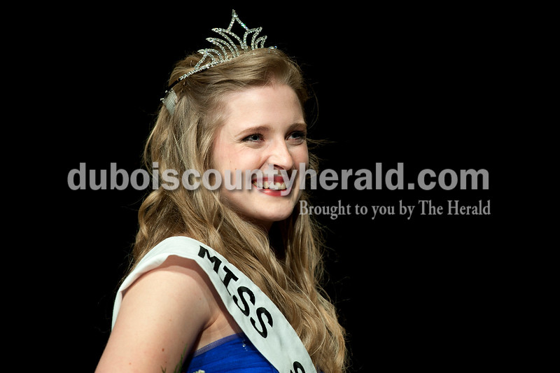 Olivia Corya/The Herald<br /> 2012 Miss Strassenfest Charlotte Olson of Jasper, 19, smiled at the audience after being crowned as the winner at the Jasper Middle School Saturday. Along with reigning at Strassenfest, Olson will receive a $1,000 scholarship for her accomplishment.