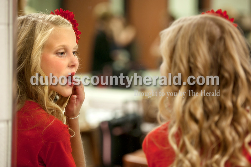 Olivia Corya/The Herald<br /> 2012 Jr. Miss Strassenfest contestant Hannah Welp of Jasper, 12, touched up her lipstick before the pageant began at the Jasper Middle School Saturday. Later in the night Welp was awarded second runner up.