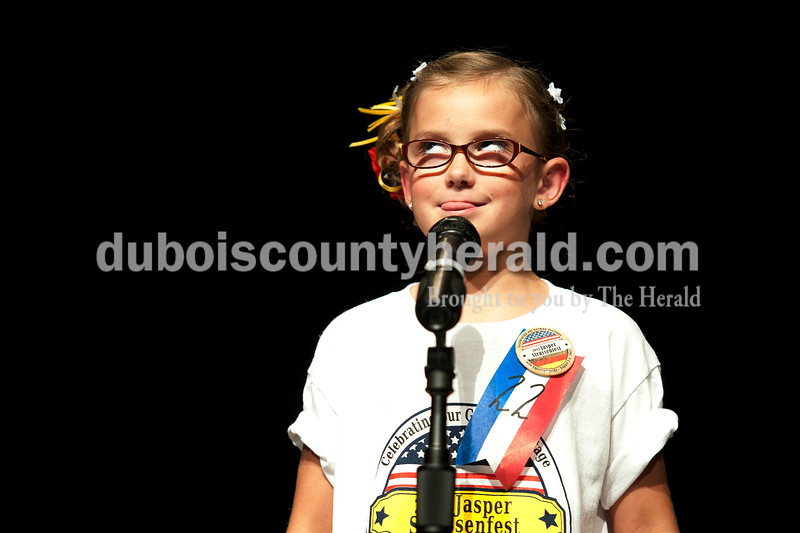 Olivia Corya/The Herald<br /> 2012 Little Miss Strassenfest contestant Libby Mehringer of Jasper, 7, concentrated as she thought of an answer to an interview question in front of a panel of judges and the audience at the Jasper Middle School Saturday. All the contestants for the Little Miss and Little Mister pageant were asked about their parents' names, pets, favorite school subjects, and hobbies.