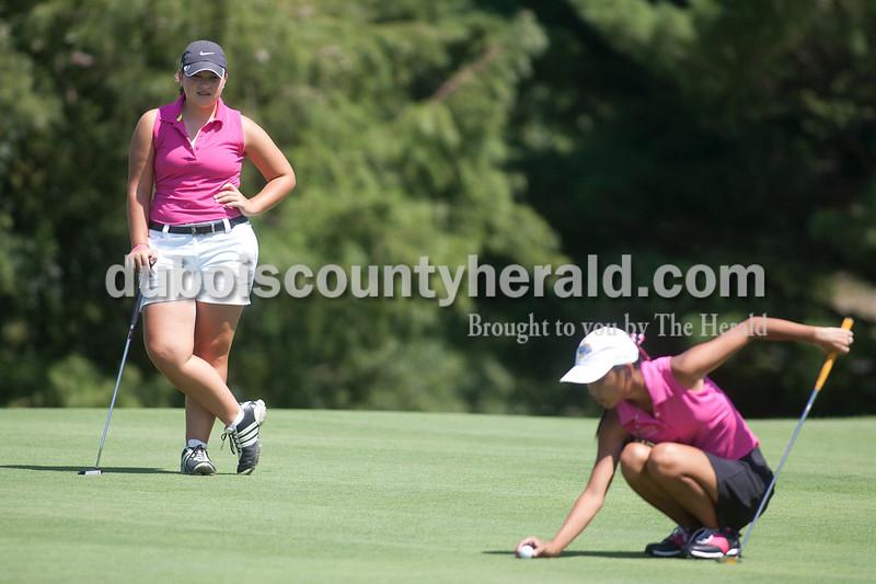 Olivia Corya/The Herald<br /> Jasper's Annie Getzin watched as Evansville North's Lauren Byers aligned her shot Saturday at Jasper Municipal Golf Course.