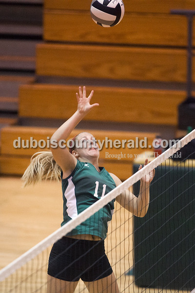 Rachel Mummey/The Herald<br /> Forest Park's Amanda Lange went up to tip the ball over the net during their match against South Spencer in Ferdinand on Monday. Forest Park won three of four sets, in which they scored 25-11, 20-25, 25-14, and 27-25.