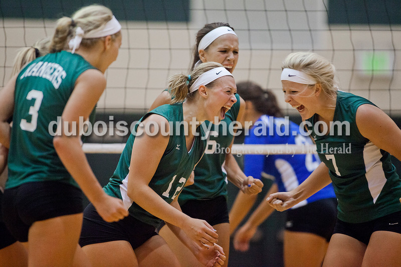 Rachel Mummey/The Herald<br /> Forest Park's Lydia Lange, far left, Mackenzie Weyer, center, Katie Fischer, second from right, and Kylie Blessinger, far right, celebrated their victory over South Spencer in Ferdinand on Monday. Forest Park won three of four sets, in which they scored 25-11, 20-25, 25-14, and 27-25.