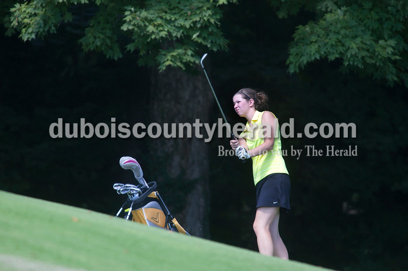 Olivia Corya/The Herald<br /> Forest Park's Rachel Metz watched her uphill shot on the eighteenth hole Saturday at Jasper Municipal Golf Course.