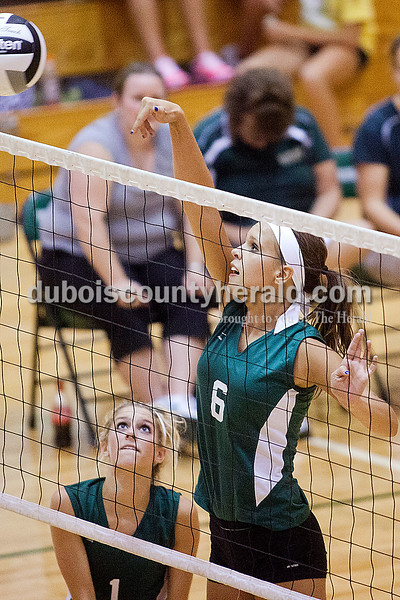 Rachel Mummey/The Herald<br /> Forest Park's Katie Fischer went up to tip the ball over the net during their match against South Spencer in Ferdinand on Monday. Forest Park won three of four sets, in which they scored 25-11, 20-25, 25-14, and 27-25.